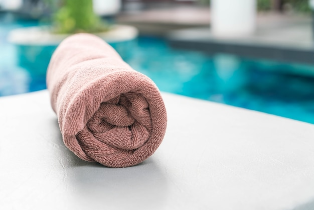 Pool towel on chair decoration around swimming pool Photo ...