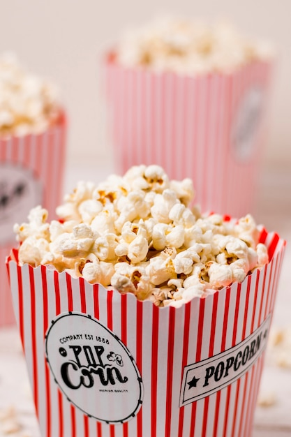 Popcorn box filled with salty fluffy popcorns Free Photo