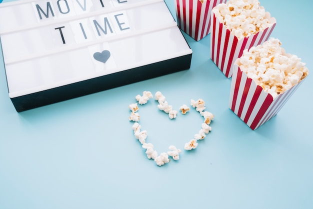 Popcorn box with a cinema sign Free Photo