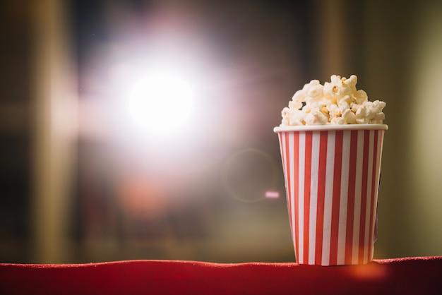 Popcorn bucket on cinema seat back Premium Photo