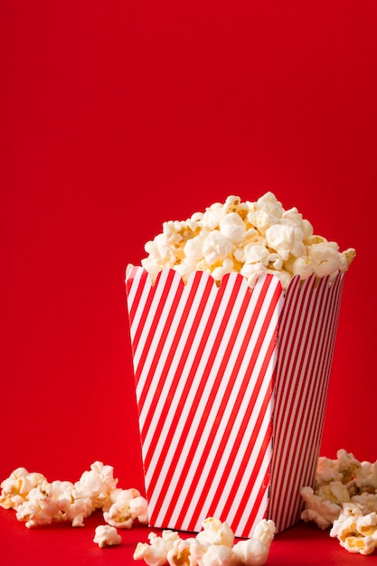 Popcorn bucket with red background Free Photo