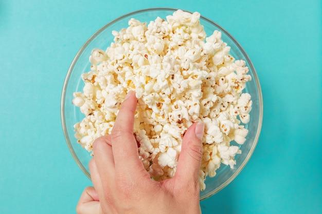 Popcorn on color background Premium Photo