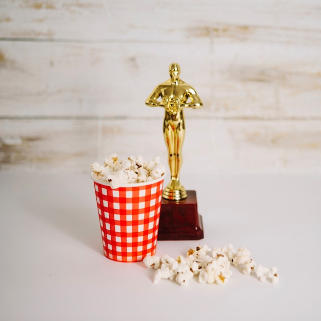 Popcorn cup and oscar statuette Free Photo