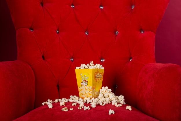 Popcorn isolated in red sofa Premium Photo