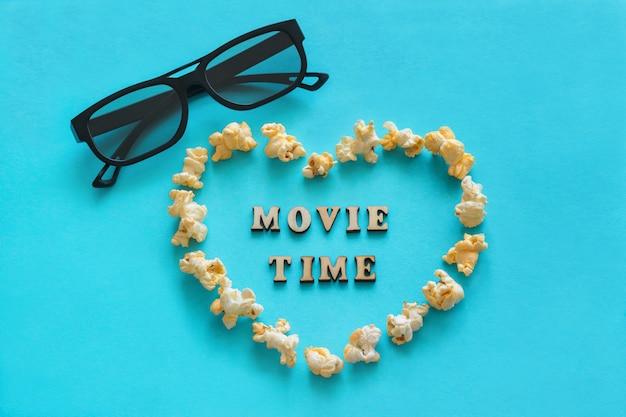 Popcorn in shape heart, 3d glasses, the text Premium Photo