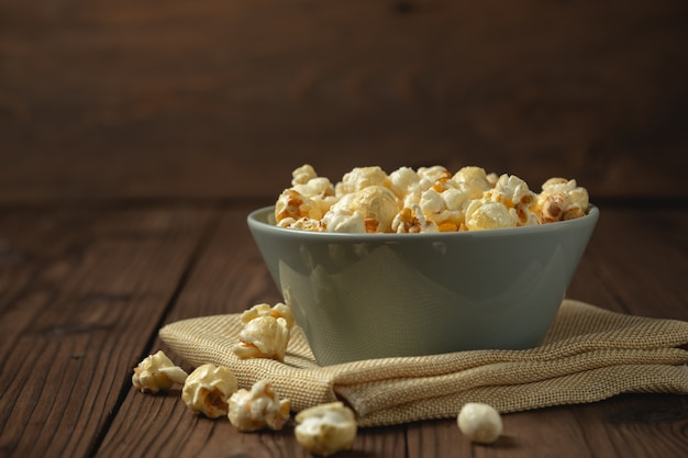 Popcorn on the wooden table. Free Photo