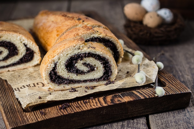 Poppy seed cake on wooden easter table. Premium Photo