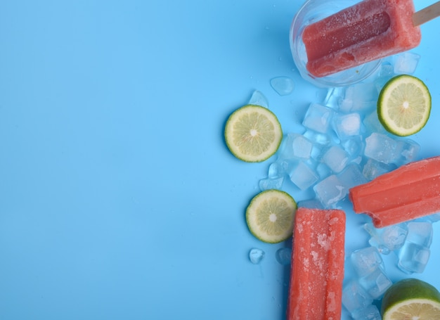 Popsicle and lemon on a blue background Free Photo