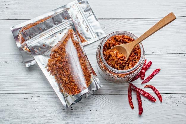 Pork crackling chili paste with the ingredient. Premium Photo