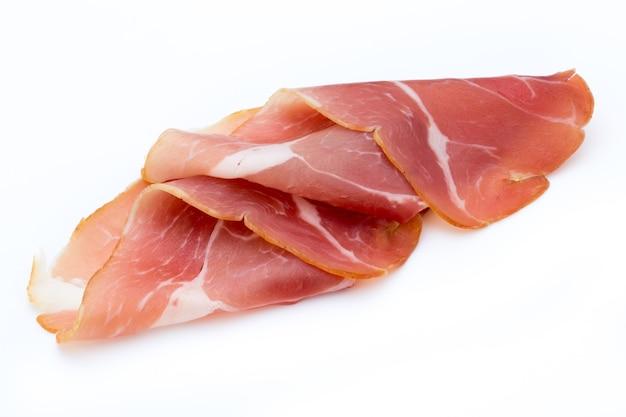 Pork ham slices isolated on white background. Premium Photo