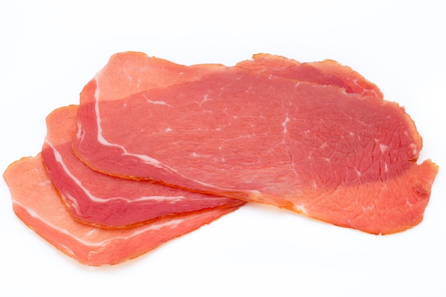 Pork ham slices isolated on white background. Premium Photo