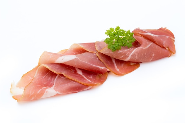 Pork ham slices isolated on white. Premium Photo
