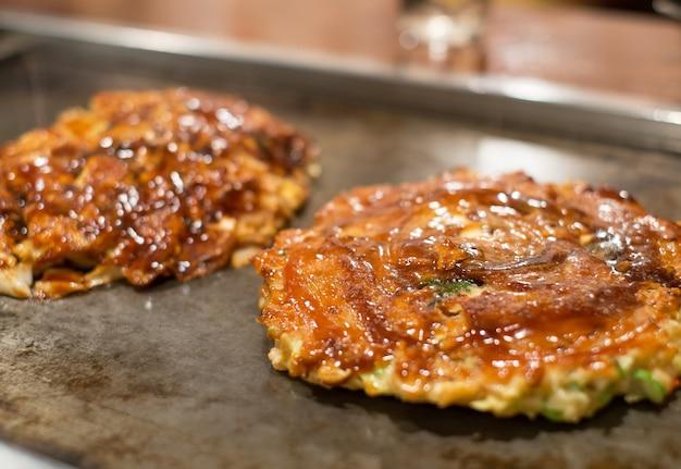 Pork okonomiyaki on hot pan Premium Photo