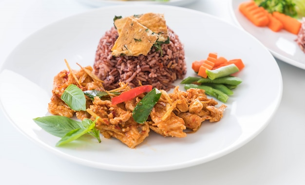 Pork panning curry with berry rice and omelet Free Photo