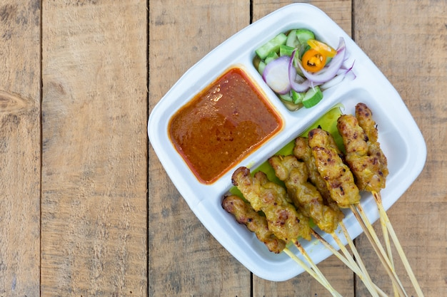 Pork satay grilled pork served with peanut sauce or sweet and sour sauce, thai food Premium Photo