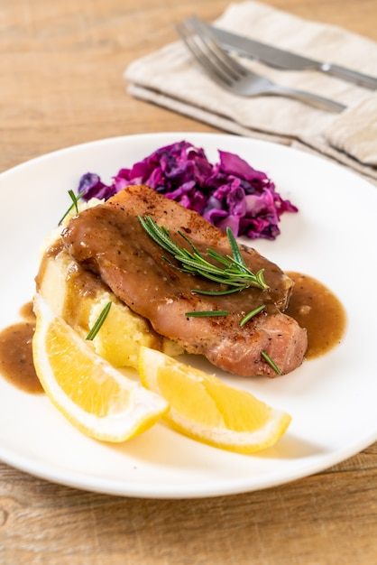 Pork steak with red cabbage and mashed potatoes Premium Photo