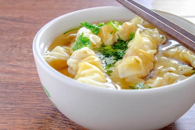 Porkwonton and dumpling in clear soup Premium Photo