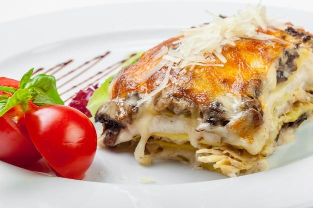 Portion of tasty lasagna, isolated on white Premium Photo