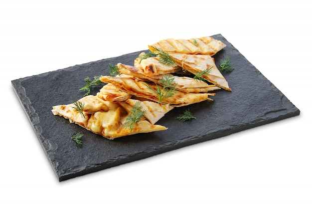 Portion of thin pita stuffed with melted cheese isolated on white Premium Photo