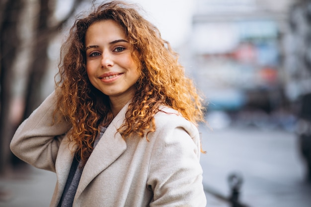 Portrair of a pretty woman with curly hair Free Photo