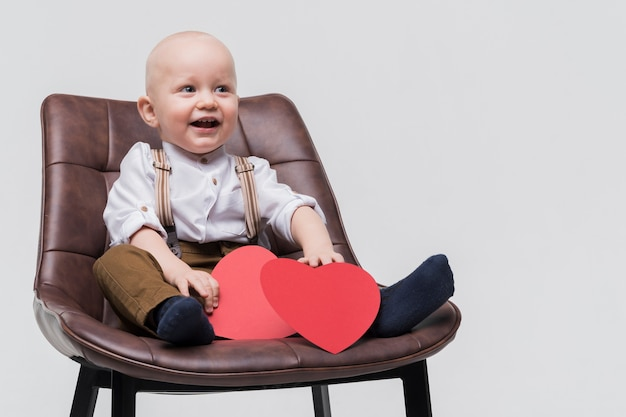 Portrait of adorable baby boy smiling Free Photo