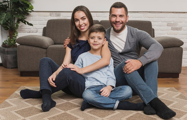 Portrait of adorable family posing Free Photo