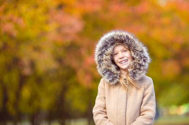 Portrait of adorable little girl outdoors at beautiful autumn day Premium Photo