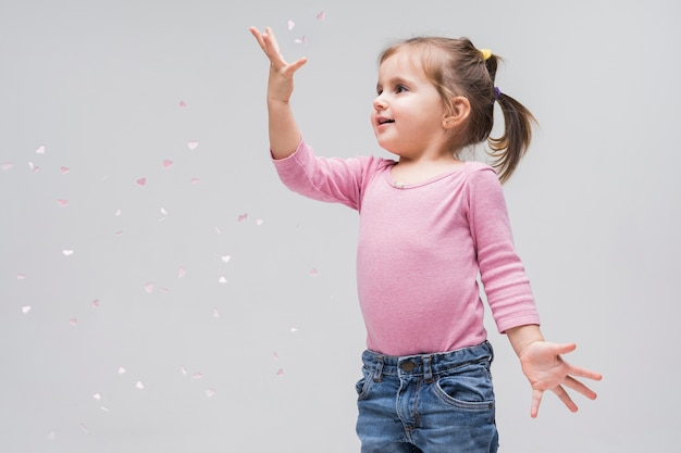Portrait of adorable little girl playing Free Photo