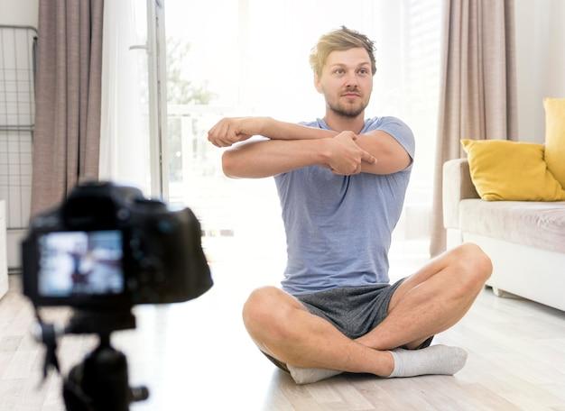 Portrait of adult male recording himself training Free Photo