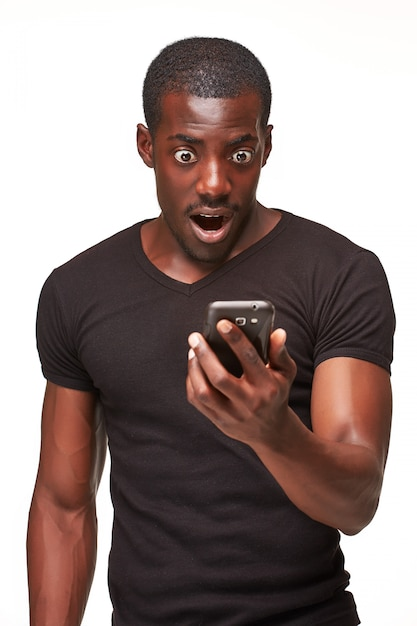 Portrait of african man talking on phone Free Photo