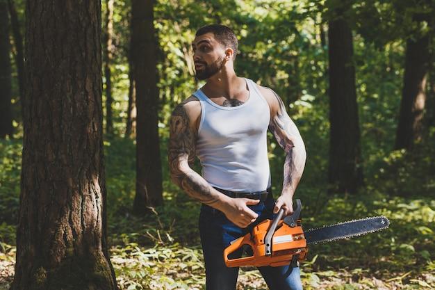 Portrait of aggressive muscular male lumberjack Premium Photo