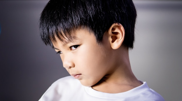 Portrait of angry tricky boy looking at camera Premium Photo