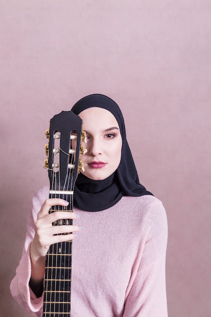 Portrait of arab woman with guitar Free Photo