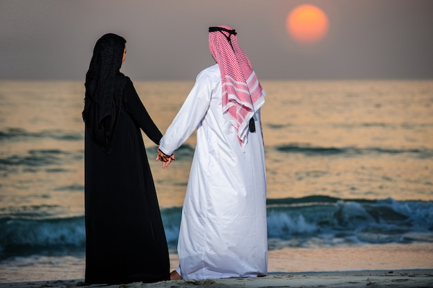 Portrait of arabic dressed yang couple. Premium Photo