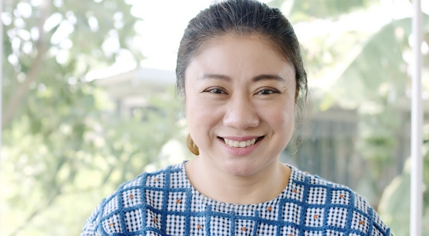 Portrait of asian attractive woman smiling brunette confident pretty. Premium Photo