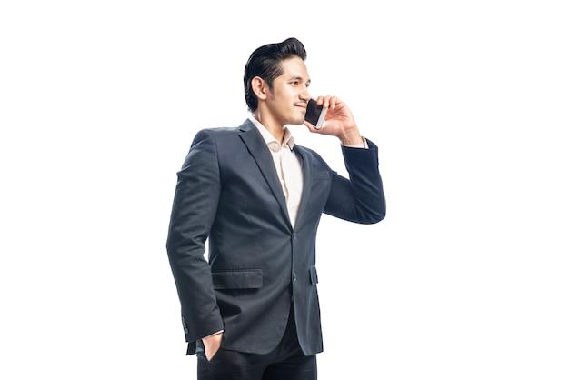 Portrait of asian businessman talking on the phone Premium Photo