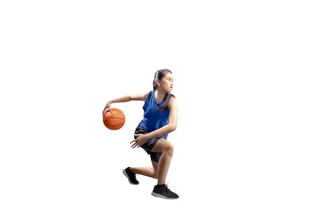Portrait of asian girl in blue sport uniform on basketball pivot moves Premium Photo