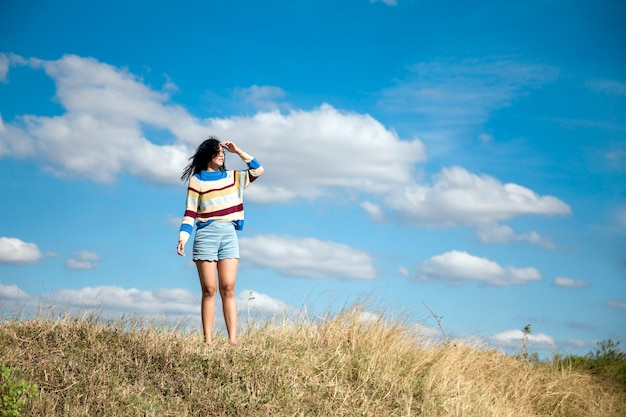 Portrait asian girl relaxation on hill with sky Premium Photo