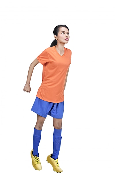Portrait of asian soccer player woman in action Premium Photo