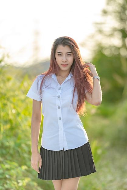 Portrait of asian or thai student university uniform beautiful girl relax and smile Premium Photo