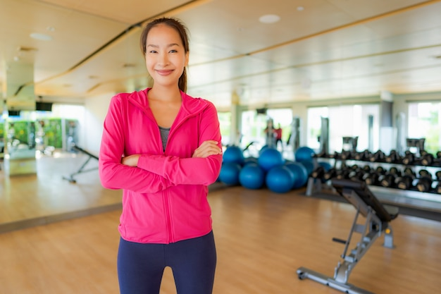 Portrait asian woman exercising and work out in gym Free Photo