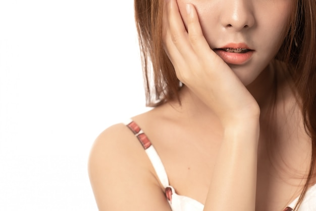 Portrait of asian woman suffering from toothache pain on white background,  woman with toothache; dental care concept;  close up asian woman model. Premium Photo