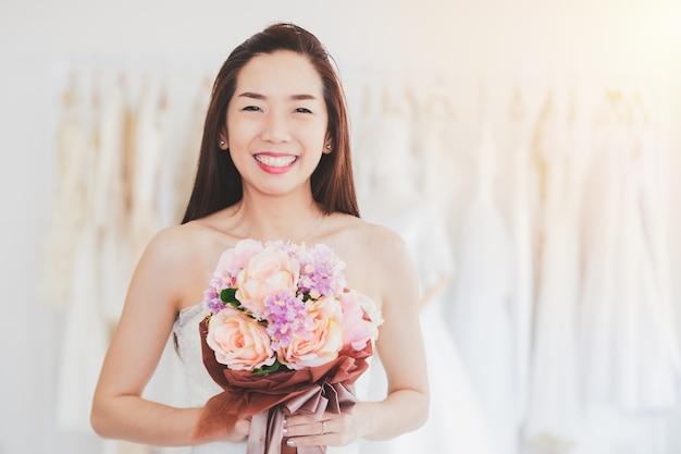 Portrait asian women cheerful happiness in wedding fashion store Premium Photo