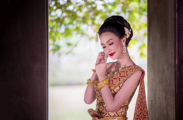 Portrait of asian women in thailand traditional costume standing Premium Photo