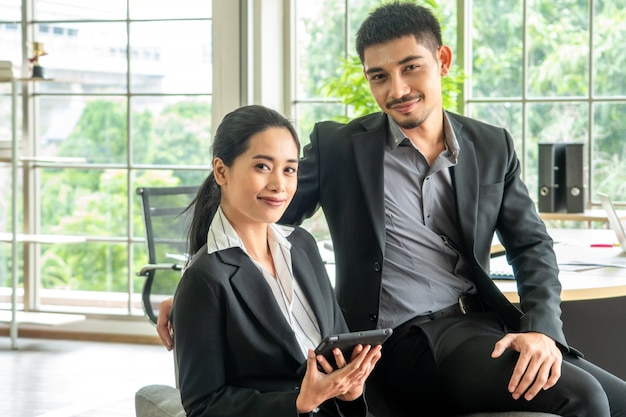 Portrait asian young couple sit on sofa together, business concept Premium Photo