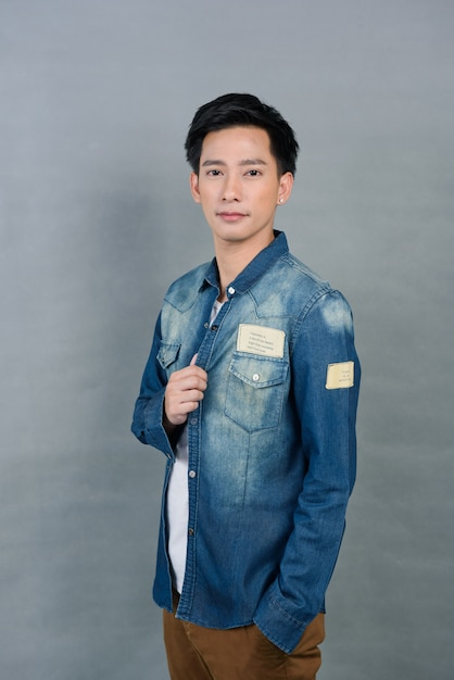 Portrait asian young man on grey, teenager Premium Photo