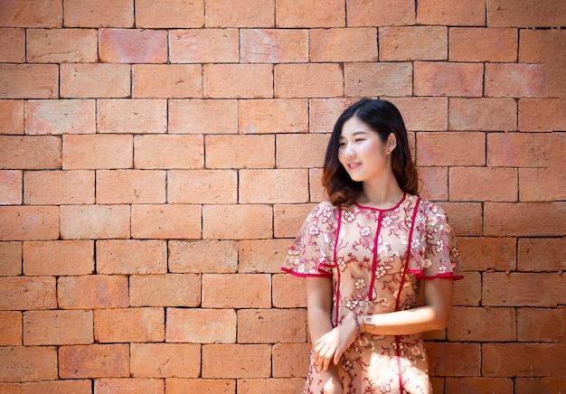 Portrait of asian young woman smiling posed Premium Photo