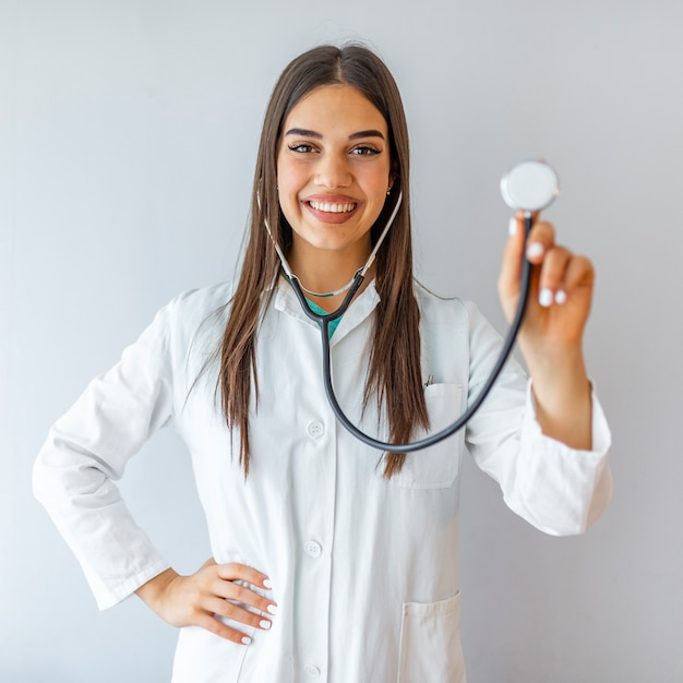 Portrait of an attractive young female doctor in white coat Premium Photo