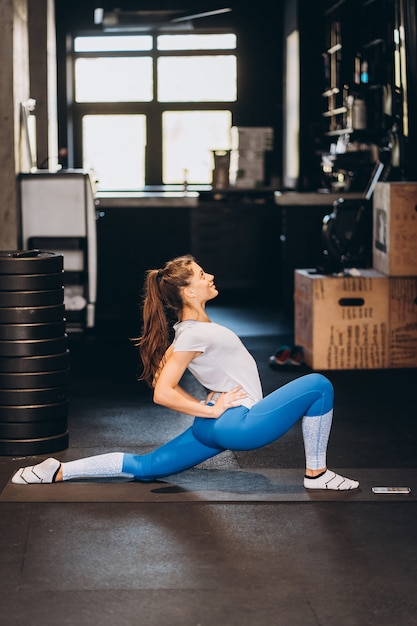 Portrait of attractive young woman doing yoga or pilates exercise Free Photo