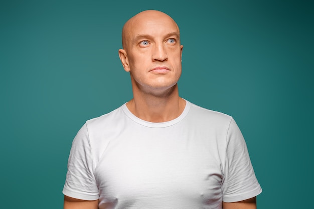Portrait of a bald man in a white t-shirt on the , facial expression Premium Photo